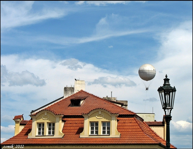 above roofs Prague