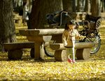 Title: Little girl who had a fallen leaf