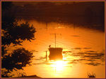 Title: Boat and sunset