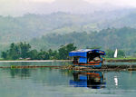 Title: A Boat On A Misty Mountain LakeCanon EOS30/Elan7E