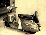 Title: Old Scooter