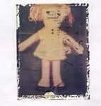 Title: toy doll polaroid