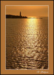 Title: Golden Sunset at Cove Island Lighthouse