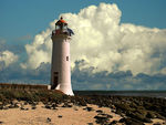 Title: Lighthouse and cloudsPentax MZ-5