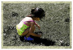 Title: Girl Playing on GrassNikon D100