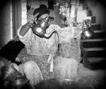 Title: Moroccan woman pouring tea