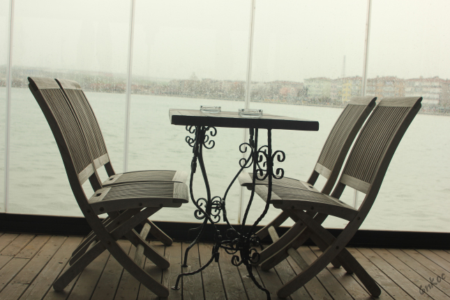 Empty chairs and rain drops