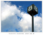 Title: Fluffy Clouds and No.8Canon Powershot S1 IS