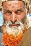 Title: Face of an Aimaqi man