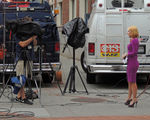 Title: TV News People at Work