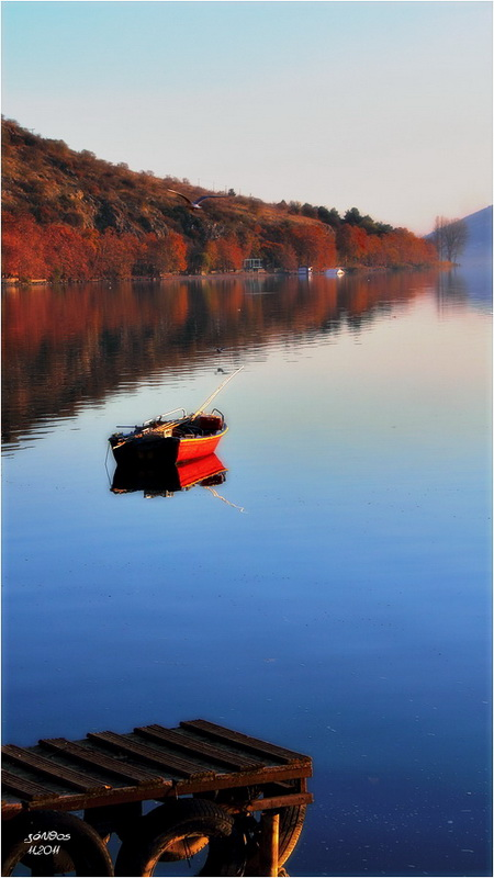red boat in the lake