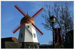 Title: A Windmill and a Village..