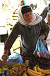 Title: Old woman at the marketNikon Coolpix S230