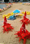 Title: Three Red Beach Umbrellas