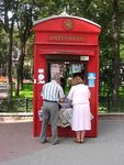 Title: At the newspaper kiosk